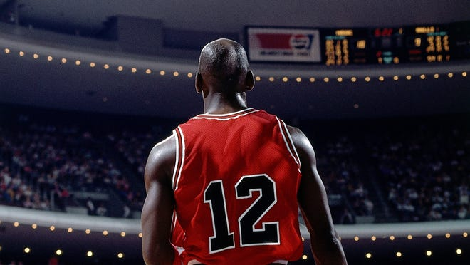 Michael Jordan of the Chicago Bulls wears a #12 jersey the only time in his career in a 1990 game against Orlando.