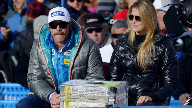 U.S. skier Bode Miller and his wife Morgan Beck  watch the Alpine Skiing World Cup men's downhill race in Beaver Creek, Colo., last month.