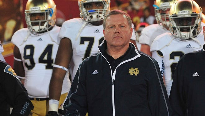 Brian Kelly complete his third season as coach at Notre Dame.