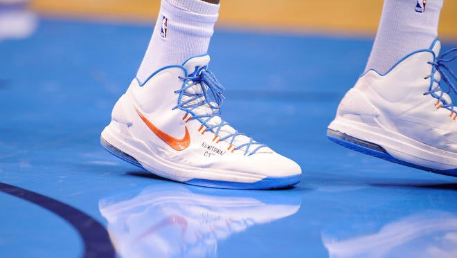 """Kevin Durant wore shoes with """"NEWTOWN CT"""" scrawled on them for a game Friday against the Kings."""