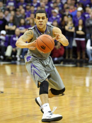 Kansas State Wildcats guard Angel Rodriguez (13) makes a pass during first-half action against the Florida Gators at the Sprint Center.