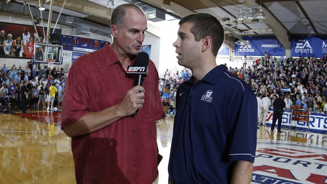 ESPN analyst Jay Bilas, shown here interviewing Brad Stevens, was not pleased with a recent NCAA ruling.