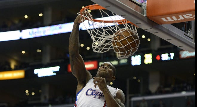 Los Angeles Clippers point guard Eric Bledsoe dunks against Sacramento Kings power forward James Johnson during the game at the Staples Center.