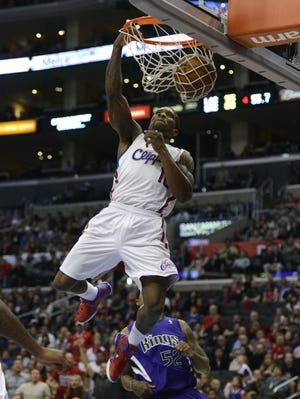 Clippers guard Eric Bledsoe dunks on an alley-oop from Chris Paul during Friday's 97-82 win vs. the Kings.