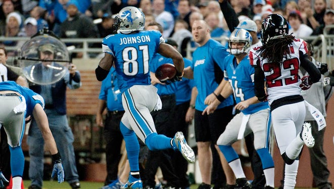 Lions wide receiver Calvin Johnson (81) runs after a catch during Saturday's game against the Falcons as part of his record-setting night.