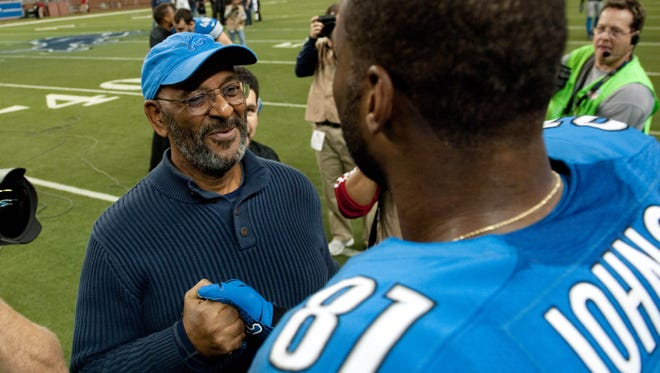 Detroit Lions wide receiver Calvin Johnson (81) is congratulated by his father Calvin Johnson Sr. after the game against the Atlanta Falcons at Ford Field.