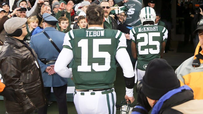 Tim Tebow runs off the field following the Jets' loss to San Diego Sunday afternoon.