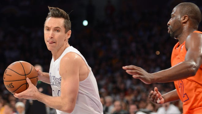 The Lakers' Steve Nash is defended by thte Knicks' Raymond Felton on Christmas Day.