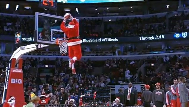 This airborne Kris Kringle got something worse than a stocking full of coal at Tuesday's Rockets-Bulls game.