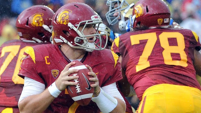 USC quarterback Matt Barkley's banner career came to an unfitting conclusion after a shoulder injury suffered against UCLA.