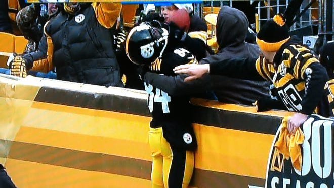 Antonio Brown celebrates with a young fan