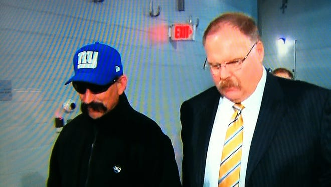 Andy Reid walks into the Eagles' Week 17 game against the New York Giants.