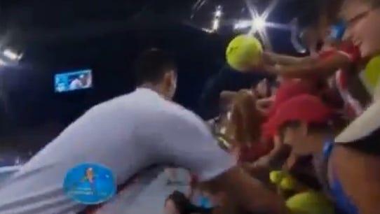 Novak Djokovic falls after a match