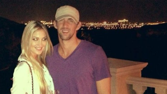 Michael Phelps and Megan Rossee pose in a picture posted on Twitter