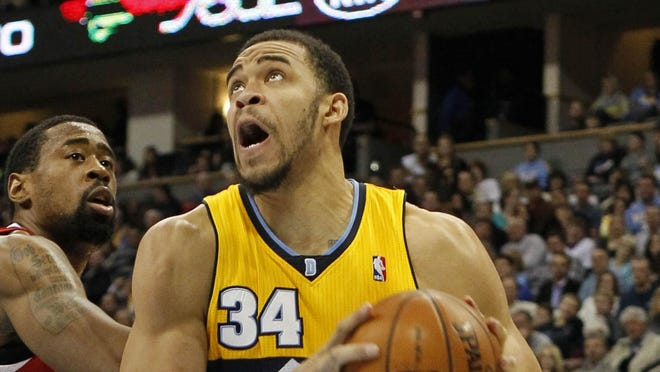 Denver Nuggets center JaVale McGee (34) drives past Los Angeles Clippers center DeAndre Jordan (6) in the third quarter at the Pepsi Center. The Nuggets beat the Clippers 92-78.