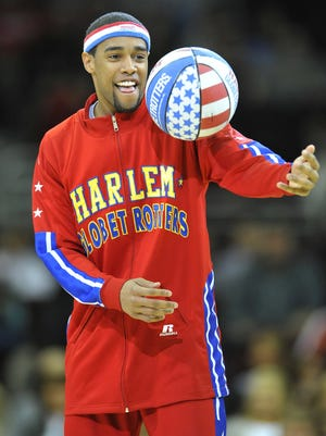 Cheese Chisholm and the rest of the Harlem Globetrotters will perform their wonders on ice Monday.
