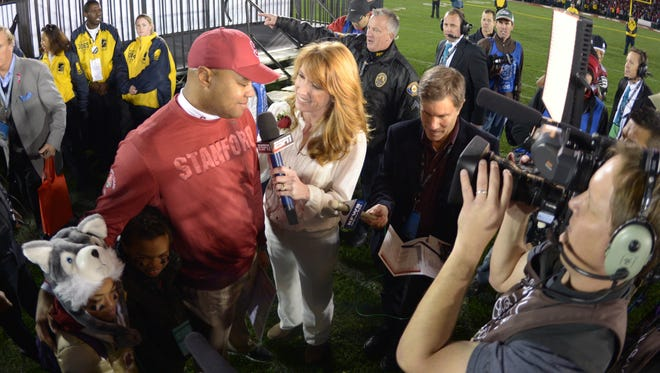 ESPN anchor Heather Cox interviews Stanford Cardinal head coach David Shaw after he won the 2013 Rose Bowl game against the Wisconsin Badgers at the Rose Bowl.