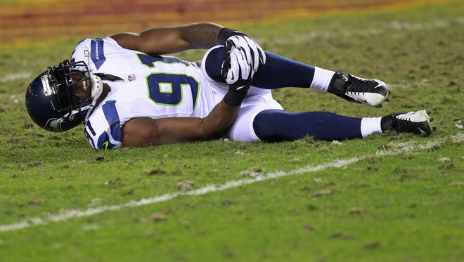Jan 6, 2013; Landover, MD, USA; Seattle Seahawks defensive end Chris Clemons (91) lies on the ground after being injured against the Washington Redskins in the fourth quarter.