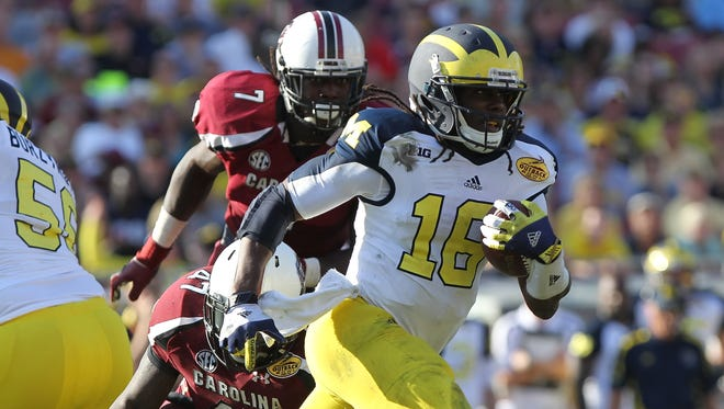 Former Michigan quarterback Denard Robinson will play wide receiver at the Senior Bowl, which points to his NFL future at the position.