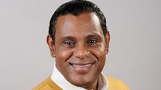 Sammy Sosa appears ready if needed for a Men's Wearhouse catalog audition.