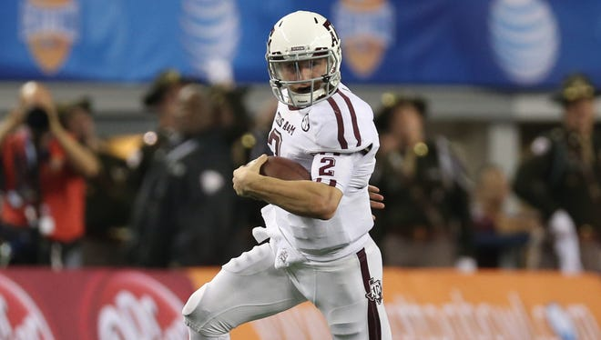 Texas A&M Aggies quarterback Johnny Manziel  scrambles in the fourth quarter against the Oklahoma Sooners during the 2013 Cotton Bowl at Cowboys Stadium. The Aggies beat the Sooners  41-13.