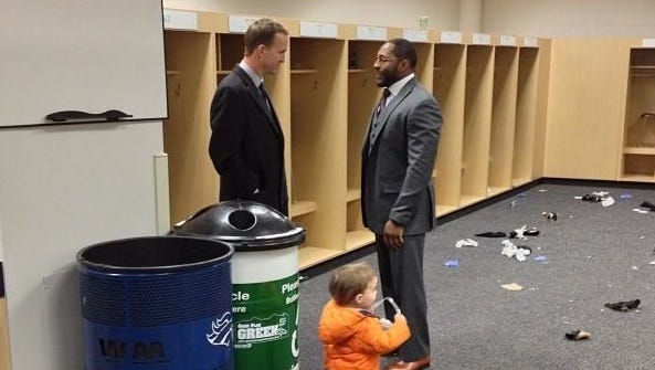 Peyton Manning and Ray Lewis meet in the Ravens locker room following Baltimore's overtime win at Denver.