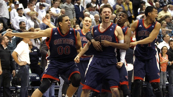 Matthew Dellavedova (4) of Saint Mary's celebrates his last-second basket with his teammates at the end of the second half of the game against BYU at the Marriott Center.