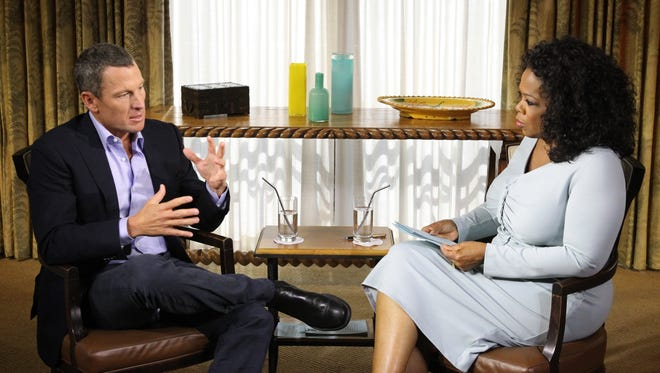 This file photo released by Oprah Winfrey Network on January 15, 2013, shows Oprah Winfrey (R) interviewing Lance Armstrong.