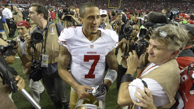 49ers quarterback Colin Kaepernick (7) celebrates after San Francisco's victory in the  NFC Championship Game against the Atlanta Falcons at the Georgia Dome.
