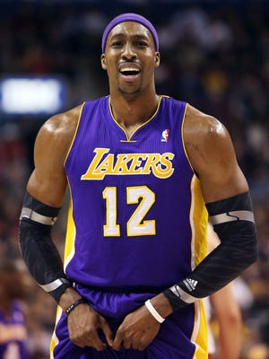 Lakers center Dwight Howard argues a second technical foul call against him during Sunday's 108-103 loss to the Raptors.