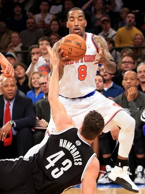 j.R. Smith and Kris Humphries fight for a loose ball during the Nets' win Monday at Madison Square Garden.