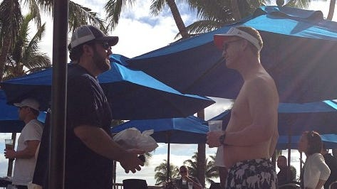 Peyton Manning in a visor and $220 swim trunks.