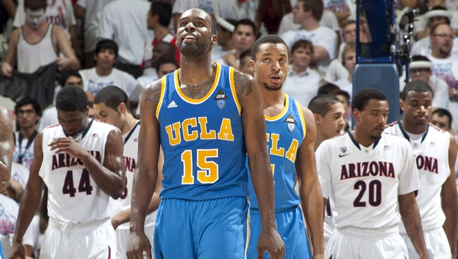 UCLA Bruins forward Shabazz Muhammad (15) smiles as he looks at the scoreboard during the second half against the Arizona Widlcats. The Bruins beat the Wildcats 84-73 on Thursday.