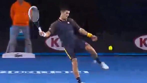Novak Djokovic kicks a ball out of frustration during the Australian Open final.