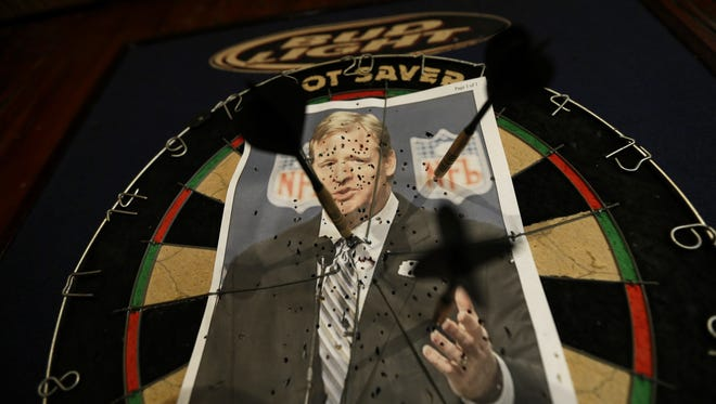 A photo of NFL commissioner Roger Goodell is seen on a dartboard inside the Parkview Tavern in New Orleans, Friday, Jan. 25, 2013. Goodell did a reddit AMA on Monday.