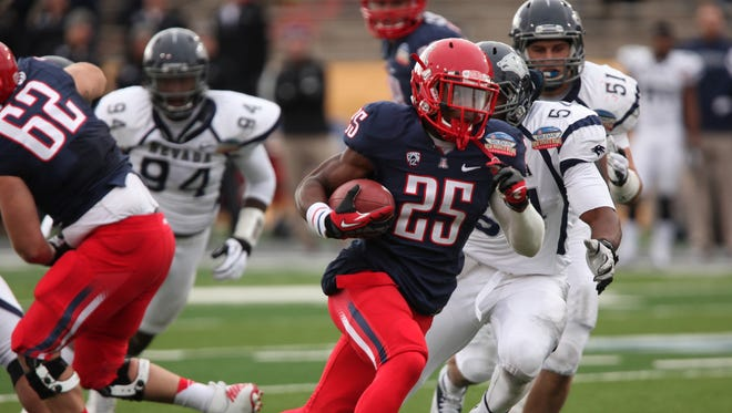 Arizona running back Ka'Deem Carey, an All-American in 2012, was removed from a Wildcats' men's basketball game on Jan. 24.