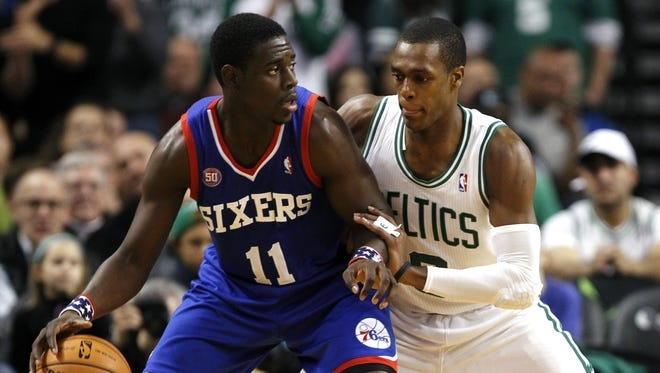 Sixers guard Jrue Holiday posts up Celtics guard Rajon Rondo during a Nov. 9 game.