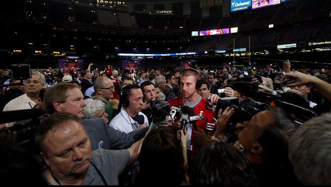 San Francisco 49ers quarterback Alex Smith is interviewed during media day.