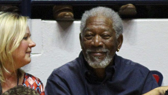 Professional actor Morgan Freeman (left) attends the game between the Mississippi Rebels and the Kentucky Wildcats at the Tad Smith Coliseum.