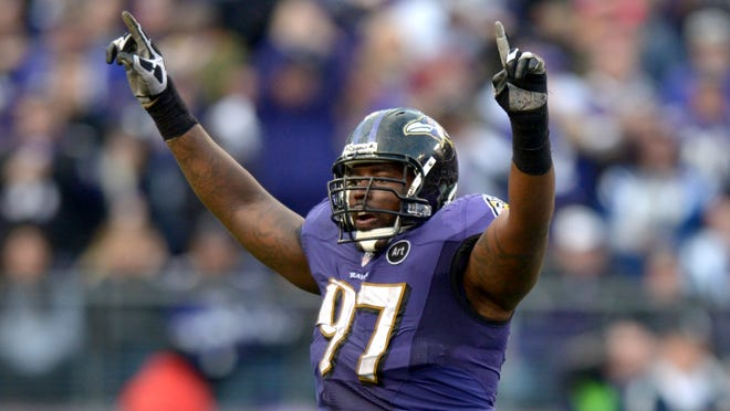 Baltimore Ravens defensive end Arthur Jones celebrates in the fourth quarter of the AFC Wild Card playoff game against the Indianapolis Colts at M&T Bank Stadium.