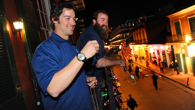 """Head & Shoulders new """"Mane Man"""" L.A. Angels pitcher C.J. Wilson and Pittsburgh Steelers Brett Keisel celebrated the launch of new Head & Shoulders with Old Spice by throwing Mardi Gras beads off famed Pat O'Brien's surrounding Super Bowl XLVII."""