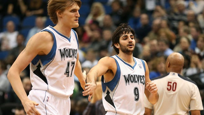 Minnesota Timberwolves point guard Ricky Rubio, right, shakes hands with small forward Andrei Kirilenko after making a shot in the second half against the Los Angeles Clippers at Target Center.