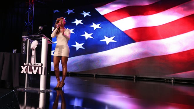 Beyonce performs the national anthem during a press conference for the Super Bowl XLVII halftime show at the New Orleans Convention Center.