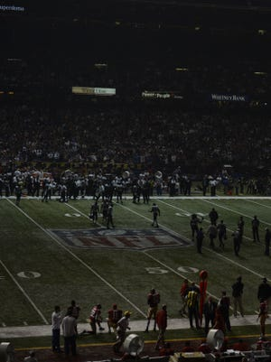 The Superdome sits in partial darkness early in the third quarter.