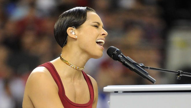 Recording artist Alicia Keys performs the national anthem before Super Bowl XLVII.