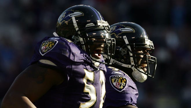 Ray Lewis, left, and Trevor Bryce celebrate during a 2006 game vs. the Bengals.
