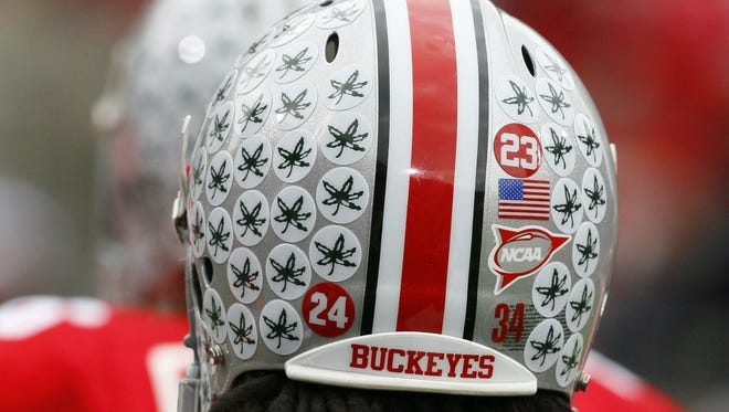 A 65-year-old Ohio State fan was pulled over after officers confused her Buckeye stickers, seen on an OSU helmet, for a marijuana symbol.