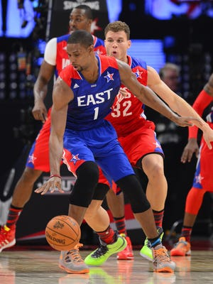 East forward Chris Bosh backs down West forward Blake Griffin during the All-Star Game on Sunday.