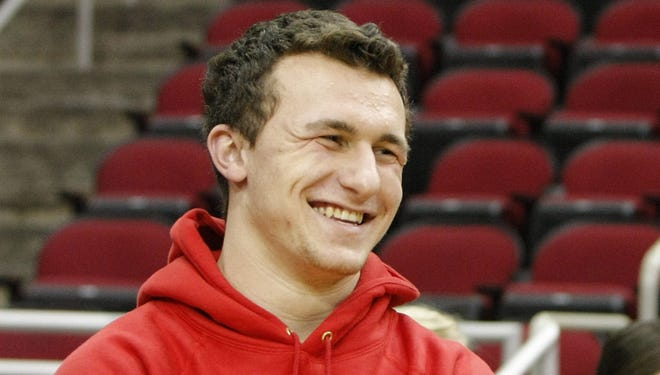 Johnny Manziel told reporters he's on Texas A&M's campus only once a  month and is taking all of his classes online.