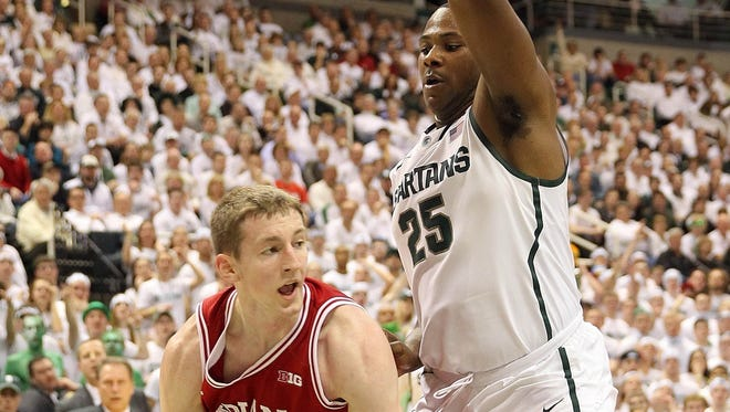 Indiana Hoosiers forward Cody Zeller, left, drives the baseline against Michigan State Spartans center Derrick Nix during first half at Jack Breslin Students Events Center in East Lansing, Mich.